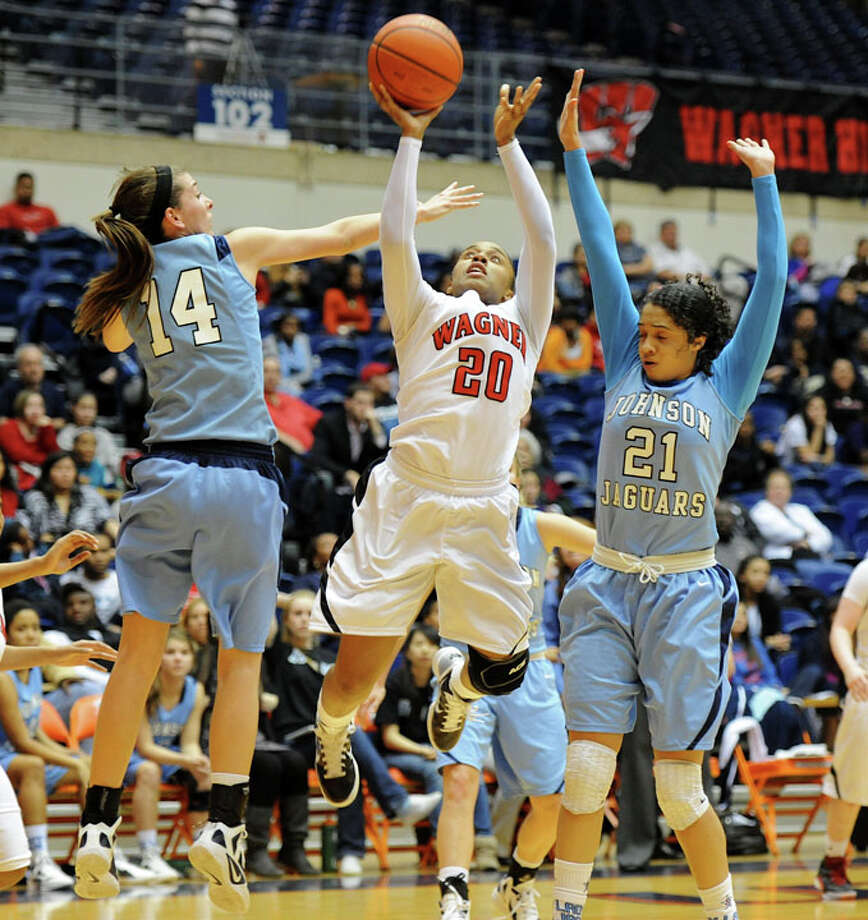 Wagner's Ashley Ross (20) gets off a shot between Johnson's Recee Caldwell (21) and Sarah Wilson (14) during a UIL 5A girls bidistrict playoff  basketball game between Johnson and Wagner at the UTSA Convocation Center in San Antonio on Monday, Feb. 13, 2012. Photo: JOHN ALBRIGHT, For The Express-News / Special to the Express-News