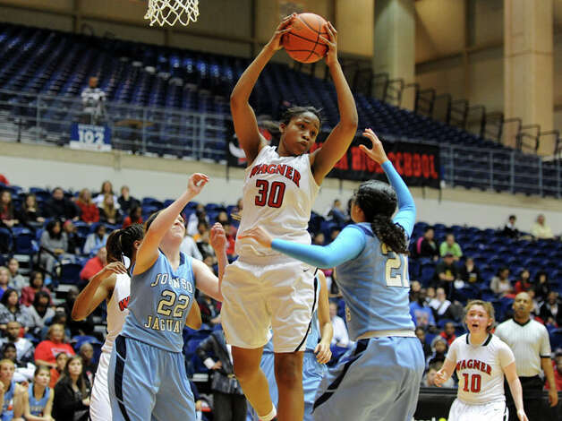 Wagner's Tesha Smith (30) grabs a rebound during a UIL 5A girls bidistrict playoff  basketball game between Johnson and Wagner at the UTSA Convocation Center in San Antonio on Monday, Feb. 13, 2012. Photo: JOHN ALBRIGHT, For The Express-News / Special to the Express-News