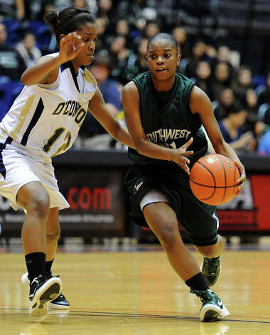 Southwest's Jazz'mere Robinson (21) dribbles past O'Connor's Alexis Copeland (12) during a UIL 5A girls bidistrict playoff  basketball game between Southwest and O'Connor at the UTSA Convocation Center in San Antonio on Monday, Feb. 13, 2012. Photo: JOHN ALBRIGHT, For The Express-News / Special to the Express-News