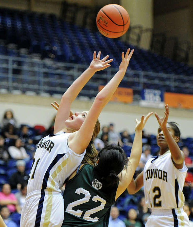 O'Connor's Shalyse Garcia (21) battles for a rebound over Southwest Cynthia Cordova (22) during a UIL 5A girls bidistrict playoff  basketball game between Southwest and O'Connor at the UTSA Convocation Center in San Antonio on Monday, Feb. 13, 2012. Photo: JOHN ALBRIGHT, For The Express-News / Special to the Express-News
