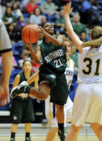 Southwest's Jazz'mere Robinson (21) takes a shot during a UIL 5A girls bidistrict playoff  basketball game between Southwest and O'Connor at the UTSA Convocation Center in San Antonio on Monday, Feb. 13, 2012. Photo: JOHN ALBRIGHT, For The Express-News / Special to the Express-News