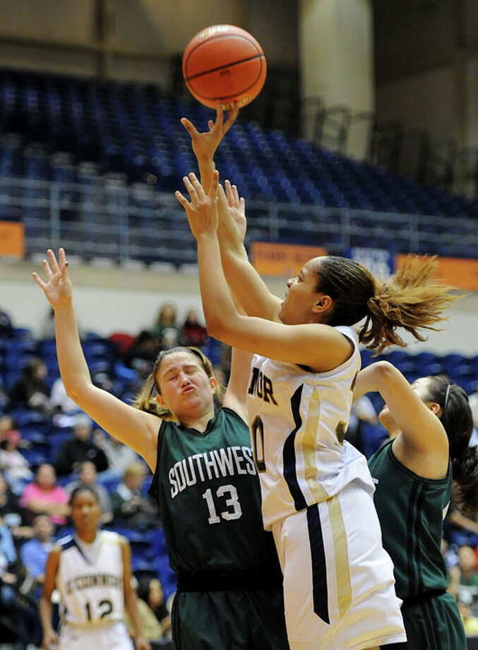 O'Connor's Ebony Easter (30) is fouled by Southwest Tiffani Rodriguez (13) as she takes a shot during a UIL 5A girls bidistrict playoff  basketball game between Southwest and O'Connor at the UTSA Convocation Center in San Antonio on Monday, Feb. 13, 2012. Photo: JOHN ALBRIGHT, For The Express-News / Special to the Express-News