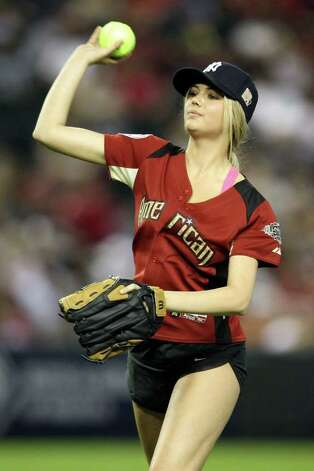 PHOENIX, AZ - JULY 10:  Model Kate Upton throws the ball during the 2011 Taco Bell All-Star Legends & Celebrity Softball Game at Chase Field on July 10, 2011 in Phoenix, Arizona.  (Photo by Christian Petersen/Getty Images) Photo: Getty Images / Getty Images 2012