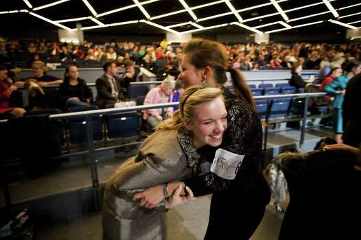 NEW YORK - FEBRUARY 13:   After making it to the finals, Sam Heiser, of Maryland, (L) hugs Katie Grohowalski during the Junior Showmanship Preliminaries at Westminster Kennel Club Dog Show on February 13, 2012 in New York City.  The Westminster Kennel Club Dog Show first held in 1877, is the second-longest continuously held sporting event in the U.S., second only to the Kentucky Derby. Photo: Michael Nagle, Getty Images / 2012 Getty Images