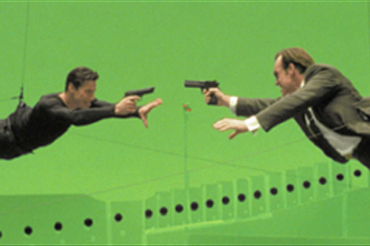 Keanu Reeves and Hugo Weaving filming a bullet time scene in The Matrix.