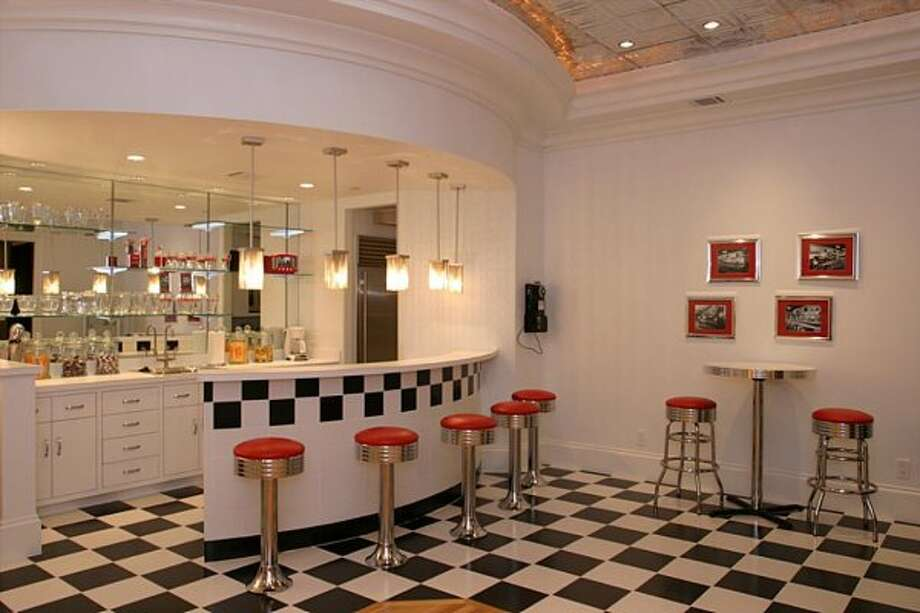 The 50''s Concession Room located on the 3rd floor outside the theater for all your concession needs. Make a milk shake, popcorn or select from the candy jars for your movie enjoyment. Complete with wood inlay dance floor and jukebox. (Coleman Realty)