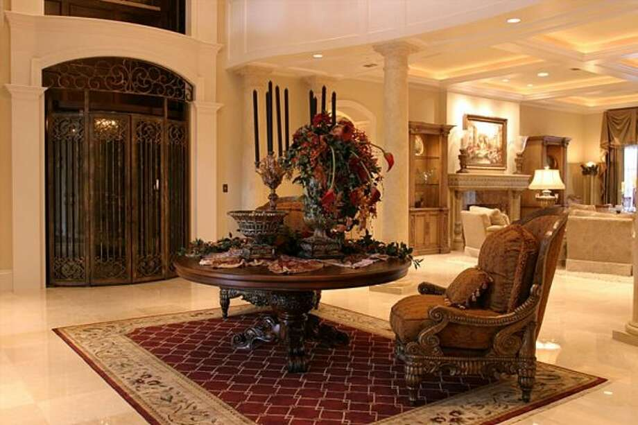 The Great Room features a custom Birdcage elevator which takes you to the 2nd floor. (Coleman Realty)