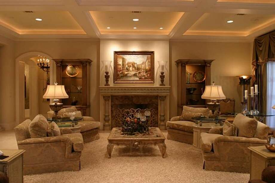 One of the Great Room sitting area with Fireplace. (Coleman Realty)