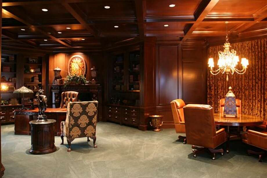 Executive office with conference area with electric drapes and a secret room. (Coleman Realty)
