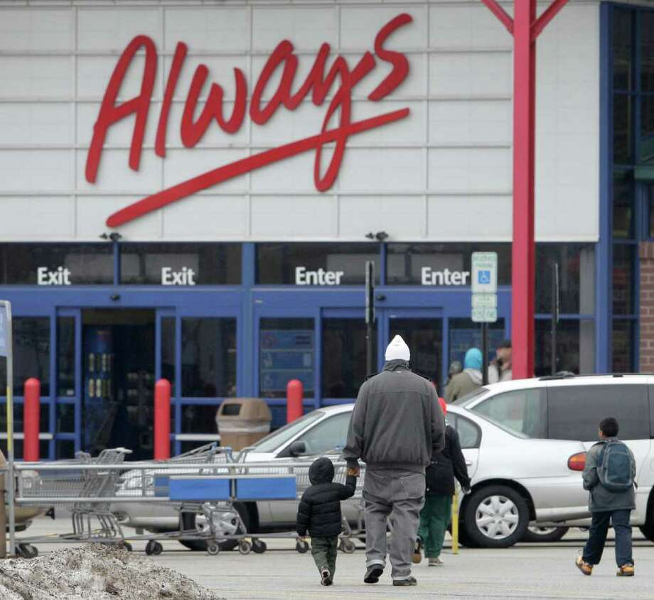 FILE - In this Feb. 2, 2012 file photo, shoppers head into the Walmart store at the Steelyard Commons shopping complex in Cleveland. Americans rebounded from a weak holiday season and stepped up spending on retail goods in January, an encouraging sign for the strengthening economy. (AP Photo/Amy Sancetta, File) Photo: Amy Sancetta / AP
