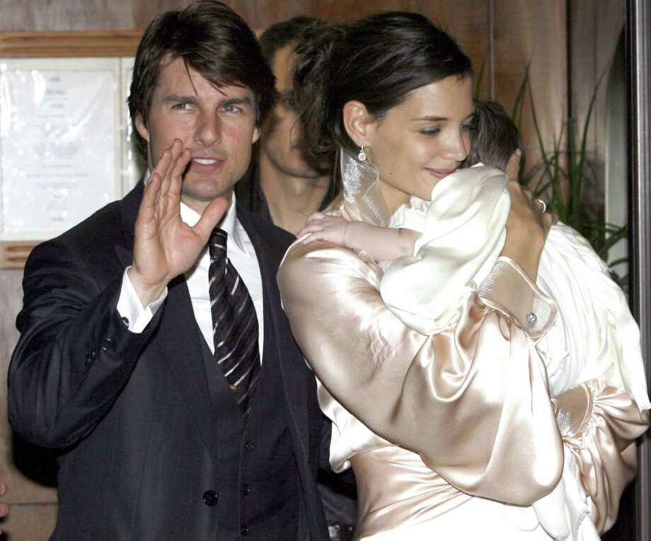 """Hate. Tom Cruise was once the hottest guy on the screen. Katie Holmes was television's sweetest teen. Then they somehow mixed and made the strangest creep in Hollywood, a Stepford Wife and a kid named """"pointy nose"""" in Indian. If you learned anything from """"Ghostbusters,"""" let it be: Don't cross the streams, folks. / AP2006"""