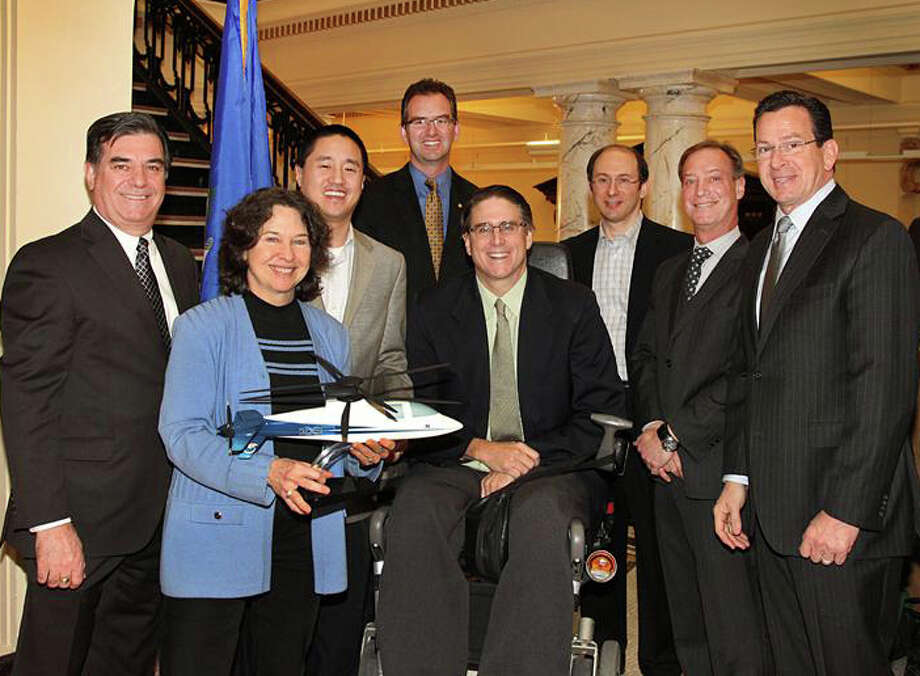 Pictured at the old Stamford Town Hall, from left, are Stamford Mayor Michael Pavia; founders Patty Meagher and New Canaan resident Ted Yang; Vice President of Sikorsky Innovations Chris Van Buiten; founders Ed Petner; Gary Breitbart and Barry Schwimmer; and Governor Dannel P. Malloy. Photo: Contributed Photo