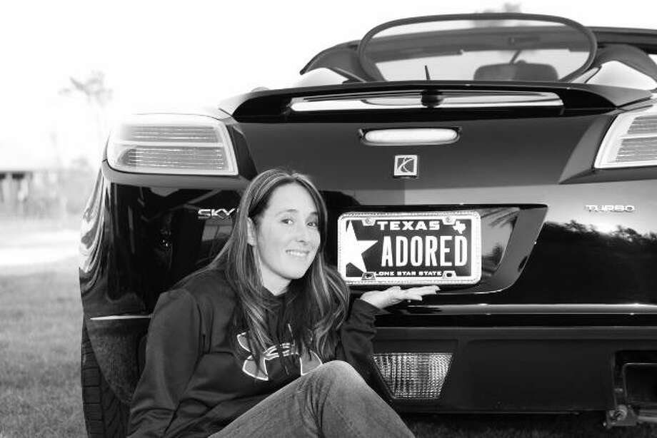 Toni Grant, of Buna, poses with her personalized license plate. photo courtesy of myplates.com Photo: Courtesy