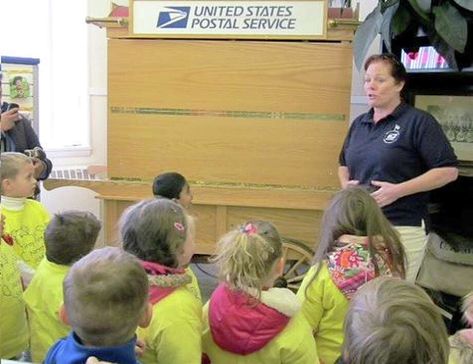 Postmaster Nancy Cornelio showed the pre-schoolers the process a letter goes through from the time it comes into the post office to when it leaves. Photo: Contributed Photo
