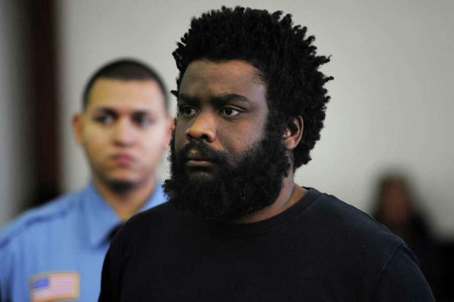 Tyree Lincoln Smith, the man charged with hacking Gonzalez to death with an ax and cannibalizing his body, was brought into Bridgeport Superior Court for a hearing on Tuesday, Feb. 14, 2012. Photo: Ned Gerard / Connecticut Post