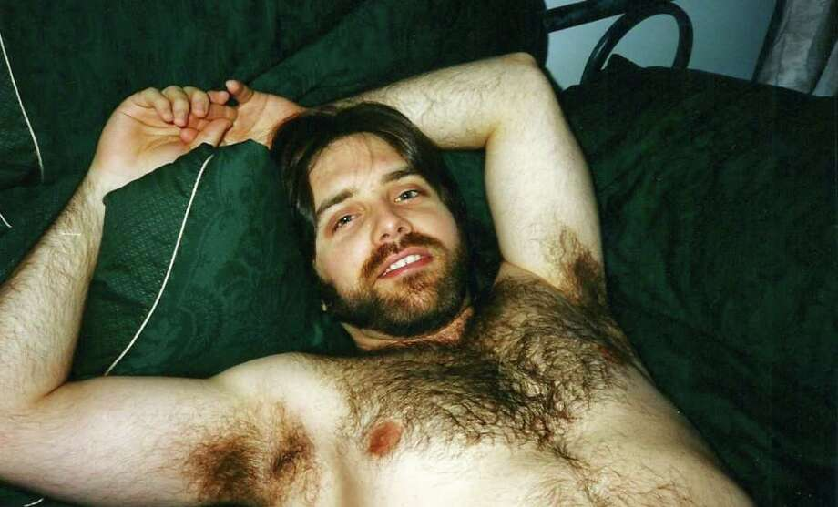 Keith Raniere relaxing in the early 1990s.