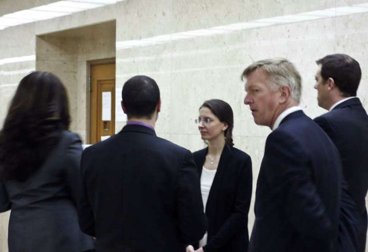 Clare Bronfman in the hallway of the Los Angeles County Courthouse March 28, 2011. Robert Crockett, second from right, and other members of her legal team are also pictured. (Special to the Times Union)