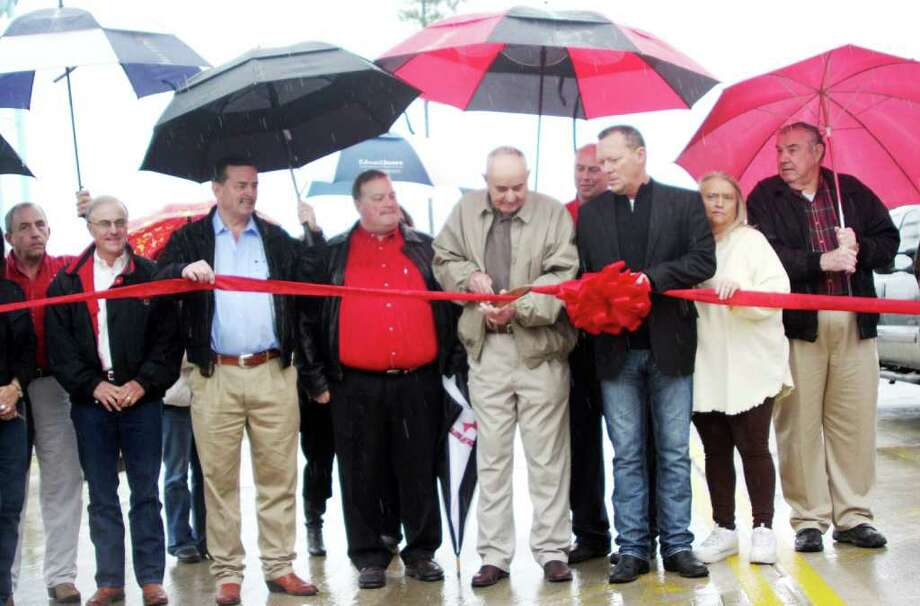 Local dignitaries turned out on a rainy Friday morning to officially open Forest Road, an infrastructure connection between Chance Cutoff and Hwy. 69 in Lumberton. Pictured; from left, City Manager Steve Clark, Randy Hicks, Ricky Simmons, State Representative Mike Hamilton, Mayor Don Surratt, City Councilmen Kenneth Wahl, Andy Kelley, Lynette Barks, and Bo Templeton. Photo: David Lisenby, HCN_Forest Road