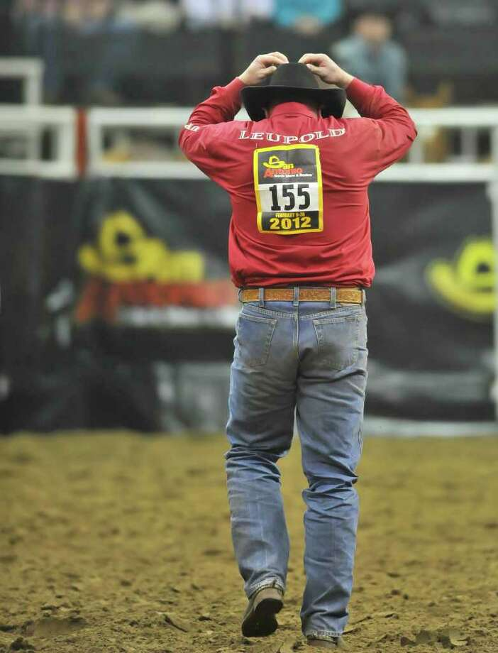 "Oregon based steer wrestler Shawn Greenfield reacts to breaking the barrier"" and incurring a 10 second penalty  Monday night during the San Antonio Stock Show and Rodeo. Photo: Robin Jerstad, Robin Jerstad/Special To The Express-News"