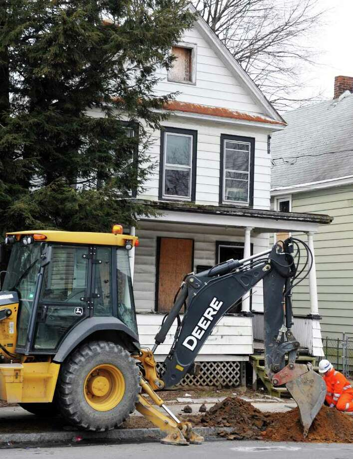 A National Grid crew works to cut the gas line to an unoccupied house at 1064 Strong Street in Schenectady after a gas leak was discovered Tuesday Feb. 14, 2012.   (John Carl D'Annibale / Times Union) Photo: John Carl D'Annibale