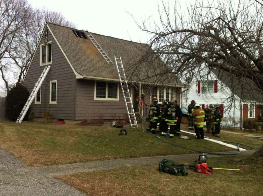 A fire broke out Tuesday, Feb. 14, 2012 in a vacant house on Ash Street in Stratford, Conn. owned by town councilman Christian Barnaby. Photo: Brittany Lyte