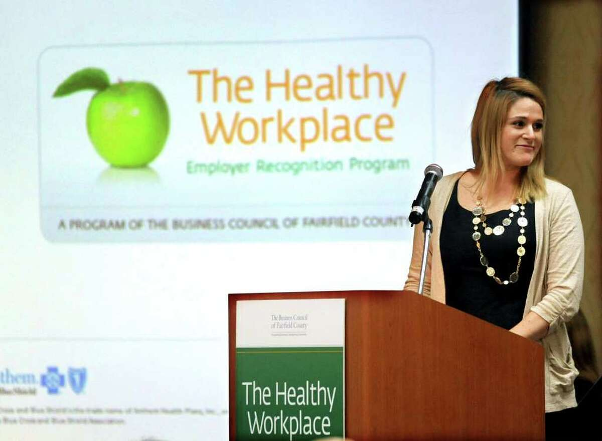 Dana Loch of Nestle Waters North America (Stamford), introduces the Journey to Wellness Panel Discussion during the Business Council of Fairfield County's Healthy Workplace Employer Recognition Program at the Sheraton Hotel in Stamford on Tuesday, February 14, 2012.