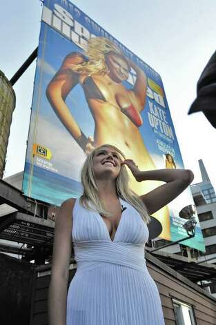 In this photo provided by CBS, model Kate Upton poses with a billboard image of the 2012 Sports Illustrated Swimsuit issue, Monday, Feb. 13, 2012 in New York as part of her appearance on Late Show with David Letterman. Upton is on the cover of the 2012 Sports Illustrated Swimsuit issue. Photo: AP
