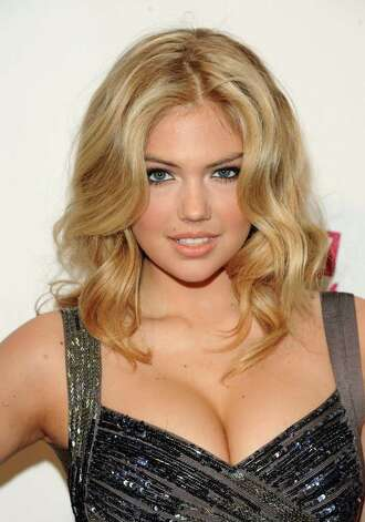 FILE - In this Feb. 15, 2011 file photo, Kate Upton attends the 2011 Sports Illustrated swimsuit issue unveiling party, in New York. She's a Florida girl who's comfortable in a bikini, and now 19-year-old model Kate Upton is on the cover of the 2012 Sports Illustrated Swimsuit issue. Photo: AP