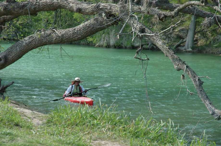 A kayaker ventures  on the Upper Guadeloupe River. (Canyon Lake Chamber of Commerce) Photo: Texas Hill Country