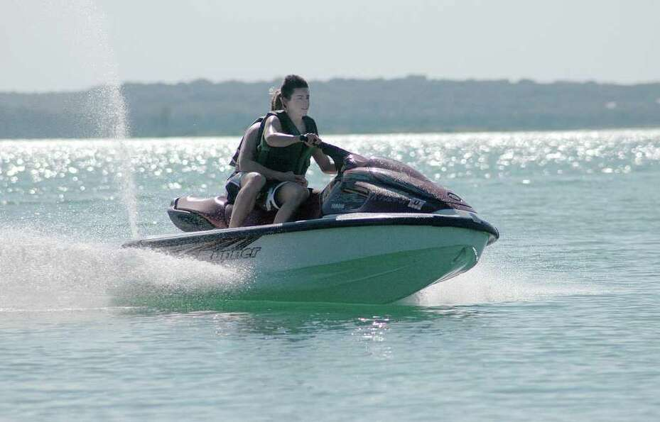 Families jet ski on Canyon Lake. (Canyon Lake Chamber of Commerce)