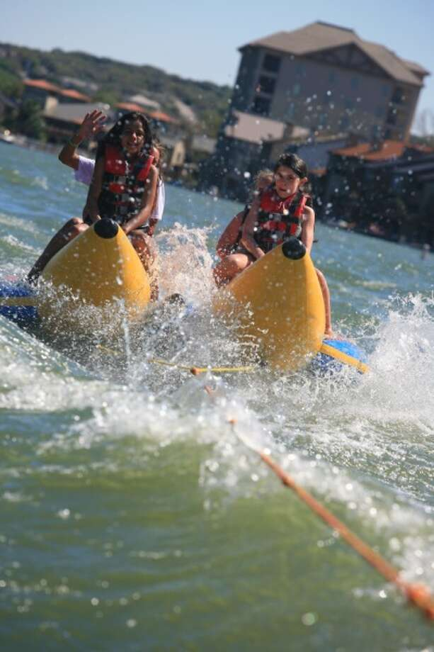 Kids take banana boat rides in Lake LBJ. (Horseshoe Bay Resort) Photo: Texas Hill Country