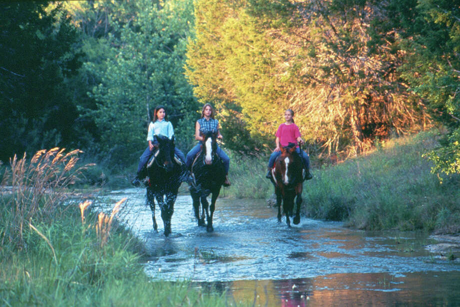 Horseback riders explore trails through Kerrville. (Kerrville Convention & Visitors Bureau) Photo: Texas Hill Country / Kerrville Convention & Visitors Bureau