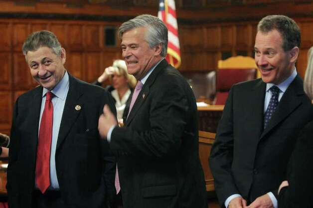 Assembly Speaker  Sheldon Silver, left, and Senate Majority Leader Dean Skelos, center, and New York State Attorney General Eric  Schneiderman, right, talk before the start of the State of the Judiciary address at the Court of Appeals on Tuesday, Feb. 14, 2012 in Albany, NY.   (Paul Buckowski / Times Union) Photo: Paul Buckowski