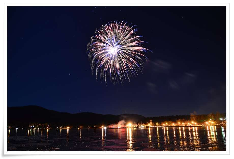 Philip Yin Winter fireworks light up the night at Lake George.