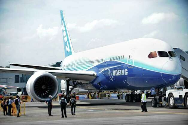 A Boeing 787 Dreamliner sits on the tarmac on display at the Singapore Airshow  in Singapore on February 14, 2012. Photo: ROSLAN RAHMAN, AFP/Getty Images / 2012 AFP