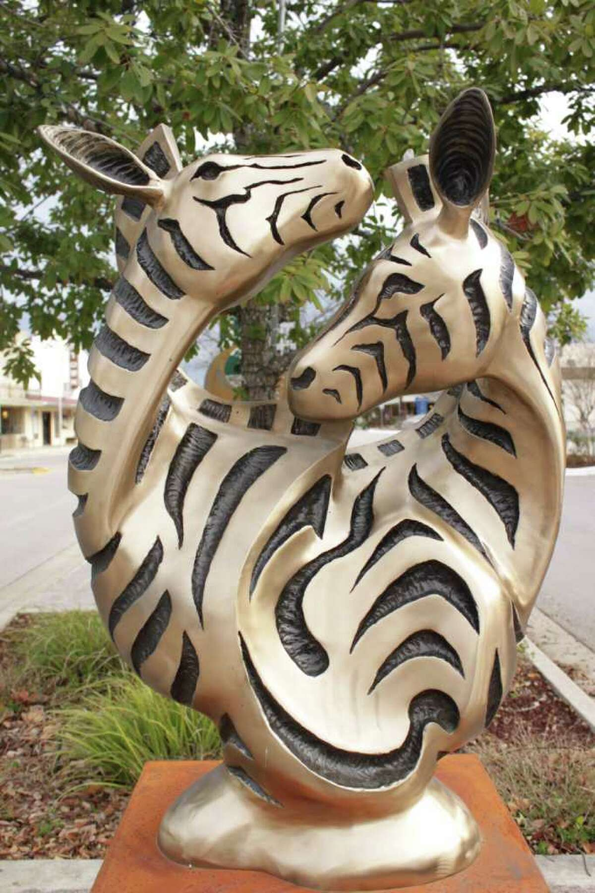 """Dan Pogue cast this bronze sculpture titled """"Matching Pair"""" in his Marble Falls foundry. The sculpture is on display on Main Street in Marble Falls."""