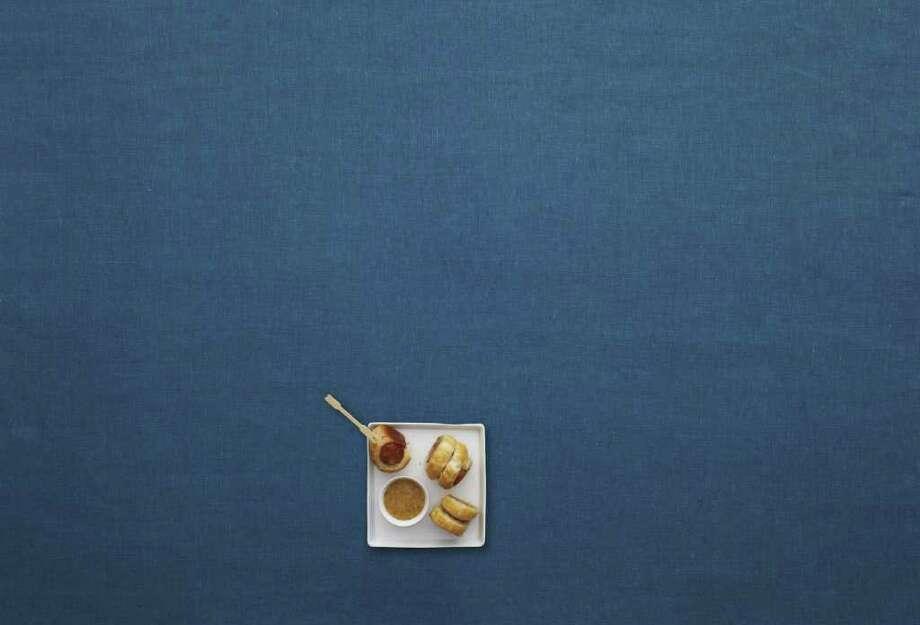 Delish: Redbook recipe for Cajun Sausage Puffs with Bourbon Mustard. Photo: Raymond Hom