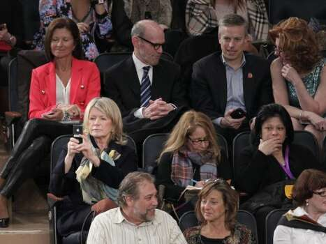 Martha Stewart, bottom left, uses her phone to capture dogs competing at the 136th annual Westminster Kennel Club dog show in New York, Monday, Feb. 13, 2012. Stewart had a dog competing in the non-sporting category. (AP Photo/Seth Wenig) (AP)