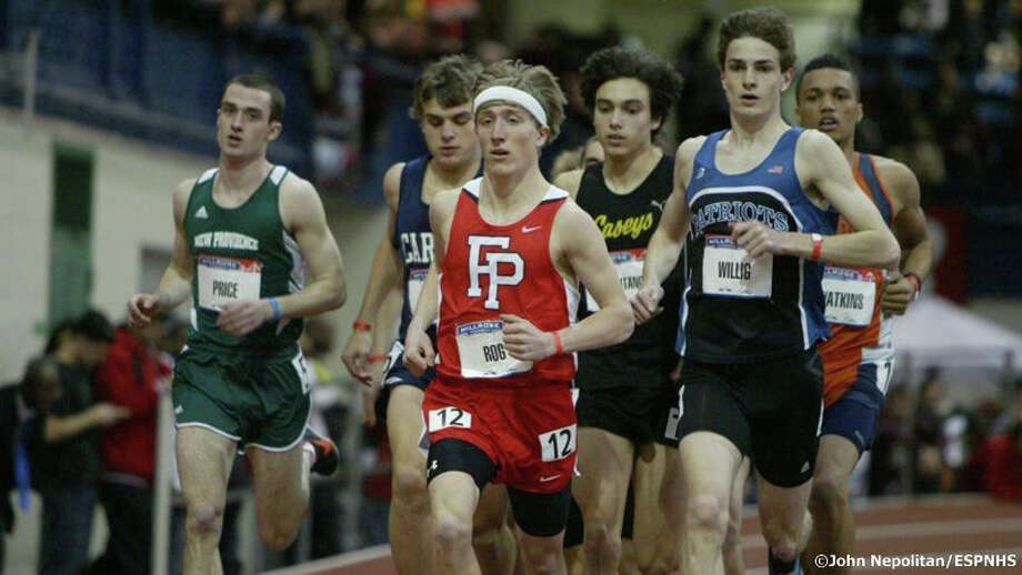 Fairfield Prep's Connor Rog leads the way at the High School mile run at the Millrose Games on Saturday at The Armory in New York. Rog finished seventh in the event. Photo: Contributed Photo