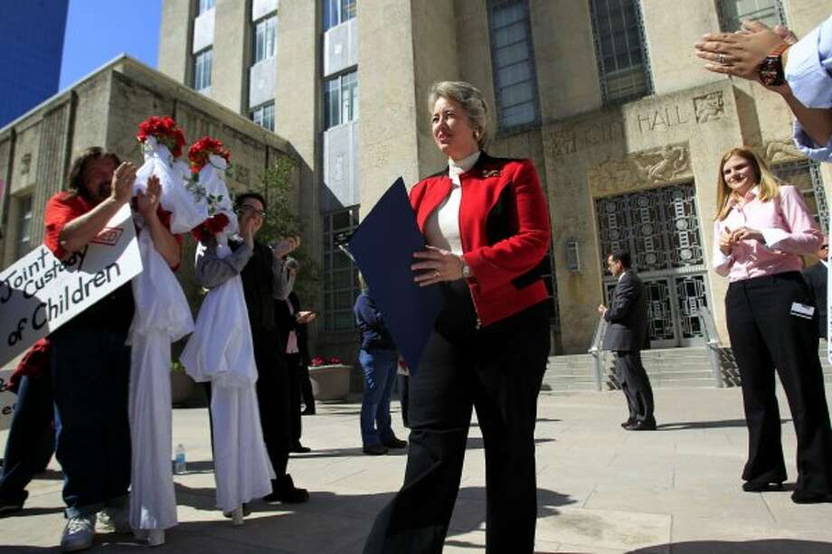 Mayor Annise Parker addresses a group of more than 30 people in support of gay marriage in front of City Hall Tuesday, Feb. 14, 2012, in Houston.  The group of gay couples and those in support of gay marriage gathered at the Harris County Clerks Office to apply for marriage licenses, where their requests were denied. The group then marched to City Hall to hold a short protest.  Mayor Annise Parker the group a proclamation. ( Johnny Hanson / Houston Chronicle ) (Houston Chronicle)