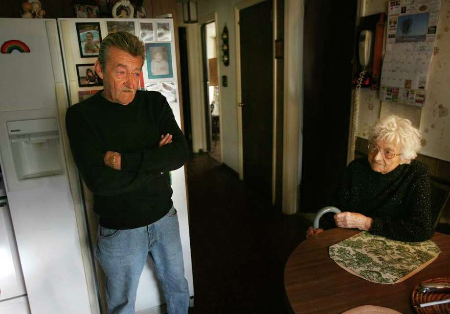 Jack Kantorowski, left of Fairfield, wants his mother Mary, 98, right, to stay in her 42 Flax Road home in Fairfield. Mary's other son, Peter, served her with eviction papers on her 98th birthday. Photo: Brian A. Pounds / Connecticut Post