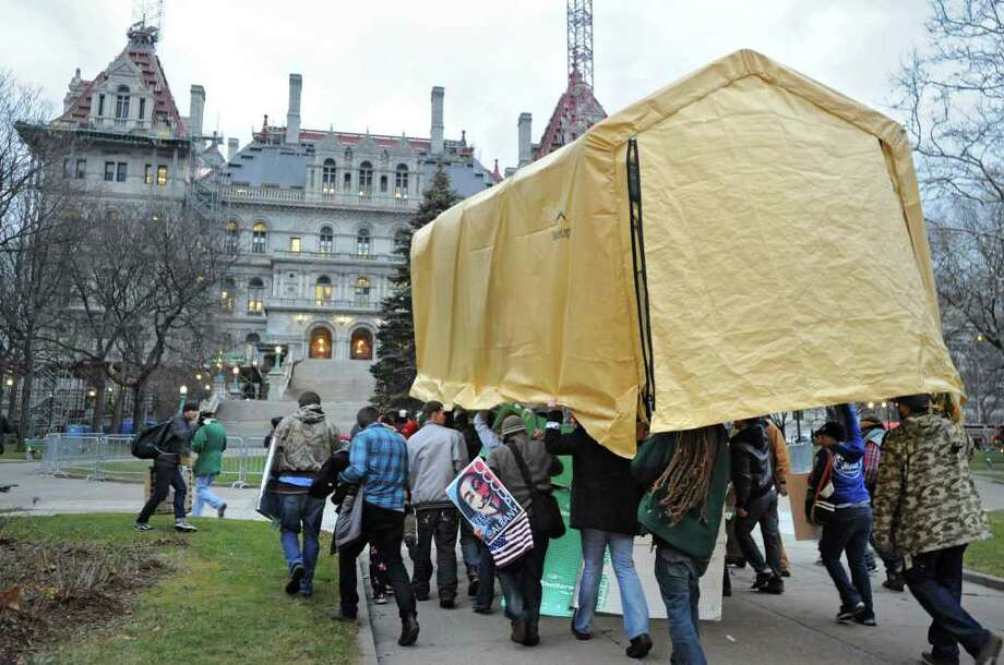 Occupy Albany members march through Albany with the last tent from Academy Park on Thursday, Dec. 22, 2011 in Albany, N.Y.  (Lori Van Buren / Times Union archive) Photo: Lori Van Buren