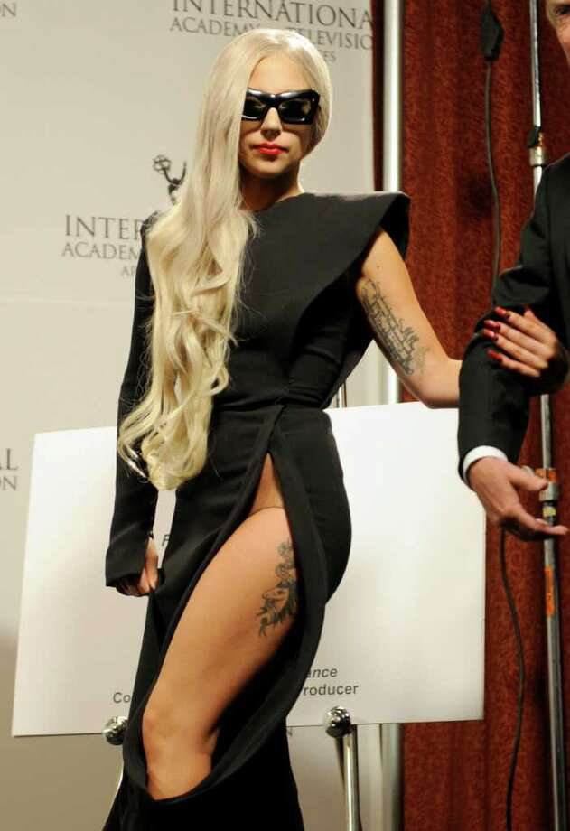 FILE - In this Nov. 21, 2011 file photo, Lady Gaga arrives in the press room at the International Emmy Awards in New York. Oprah Winfrey and U.S. Health and Human Services Secretary Kathleen Sebelius are among those scheduled to join Lady Gaga at Harvard University this month for the launch of the singer's Born This Way Foundation. The nonprofit is scheduled to be unveiled Feb. 29 at Harvard's Graduate School of Education before policy makers, foundation leaders and youth.  (AP Photo/Henny Ray Abrams, file) Photo: Henny Ray Abrams
