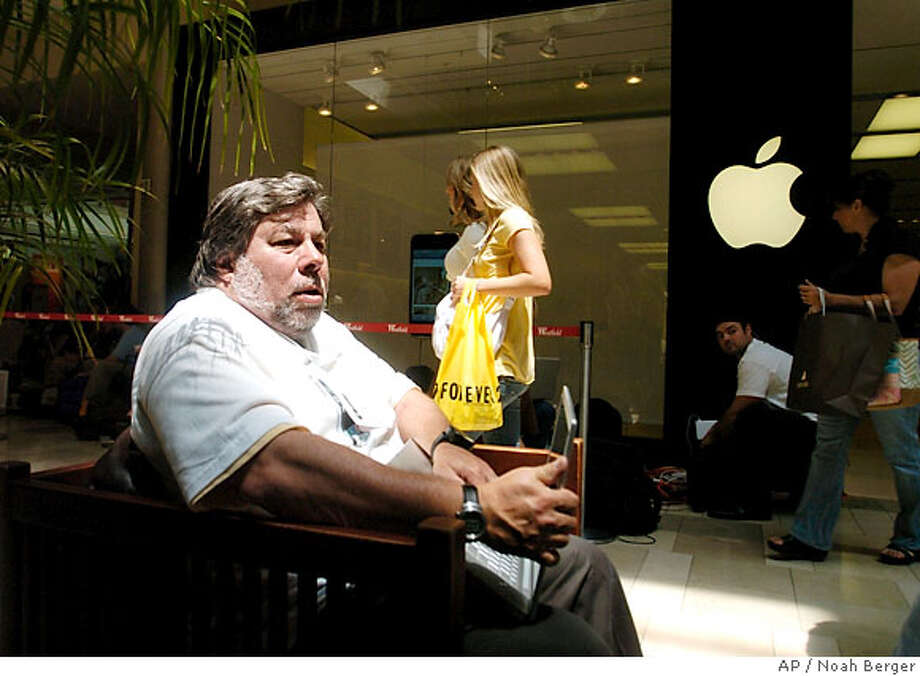 Apple, Inc. co-founder Steve Wozniak waits outside a Santa Clara, Calif., Apple retail store to buy an iPhone on Friday, June 29, 2007. Wearing an iPhone shirt created by friends, Woziak arrived around 4 a.m. to await the first sales of the phone at 6 p.m. local time. (AP Photo/Noah Berger) Photo: Noah Berger