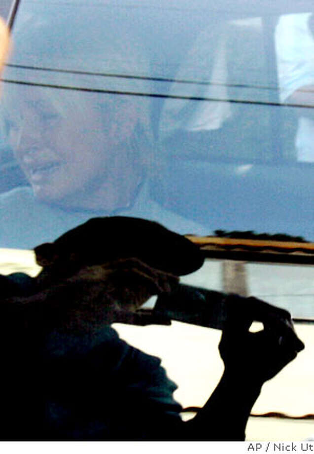 ** ALTERNATE CROP ** Paris Hilton is transported in a police car from her home to court by the Los Angeles County Sheriff's Department in Los Angeles on Friday, June 8, 2007. (AP Photo/Nick Ut) Photo: Nick Ut