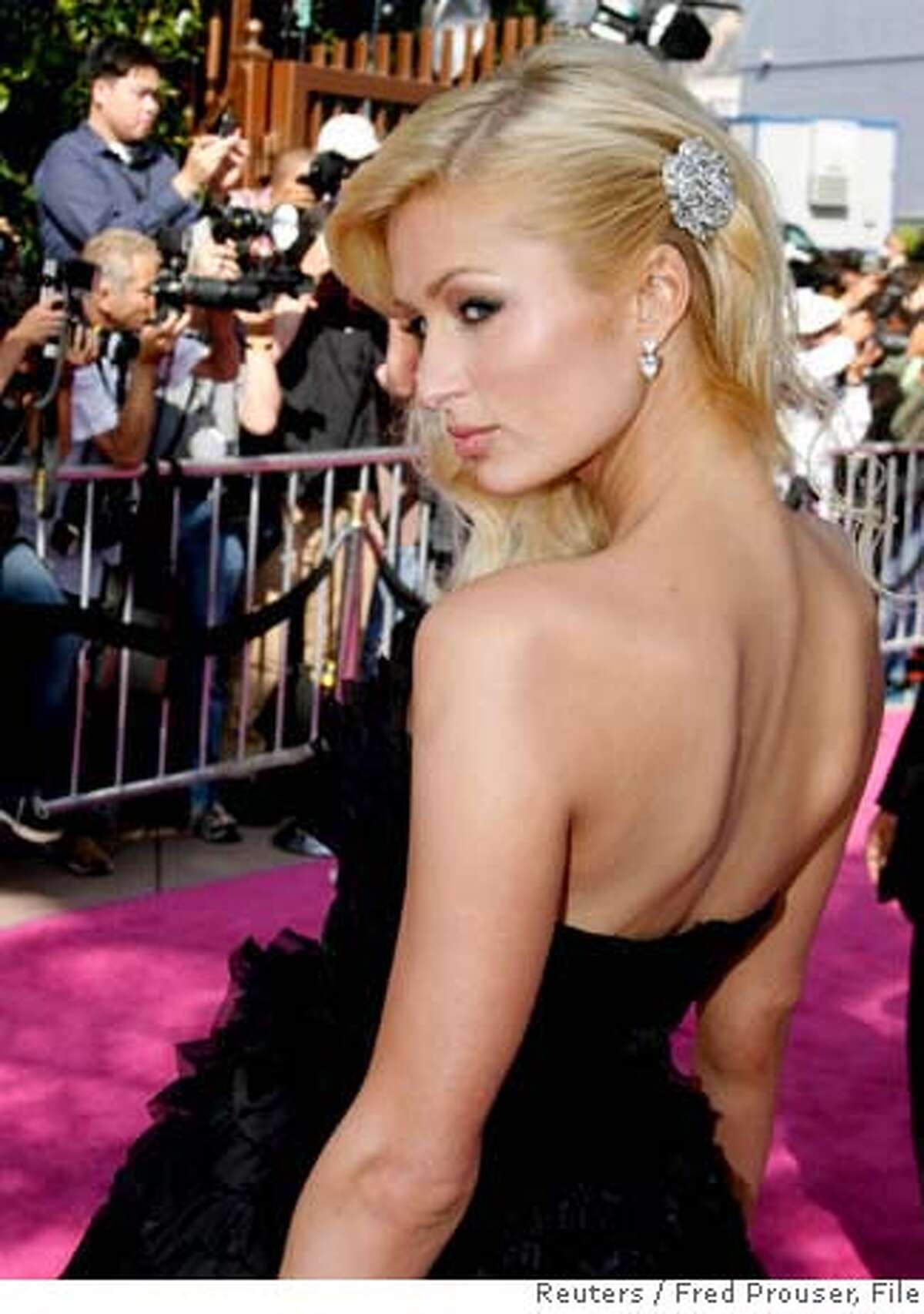 Paris Hilton arrives at the 2007 MTV Movie Awards in Los Angeles, California in this June 3, 2007 file photo. Hilton has been released after serving three days of a 23-day jail sentence in Los Angeles, a celebrity news Web site reported on June 7, 2007. REUTERS/Fred Prouser/Files (UNITED STATES) 0