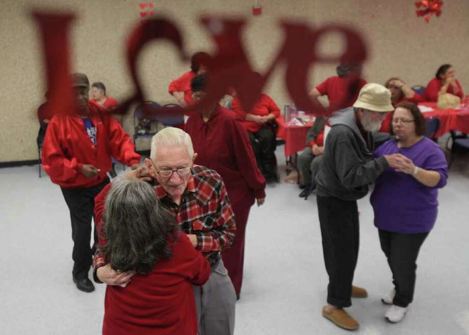 Senior citizens slow dance during the Valentine's Day Dance at the Neighborhood Center Inc. West End Senior Center. Photo: Mayra Beltran, Houston Chronicle / © 2012 Houston Chronicle