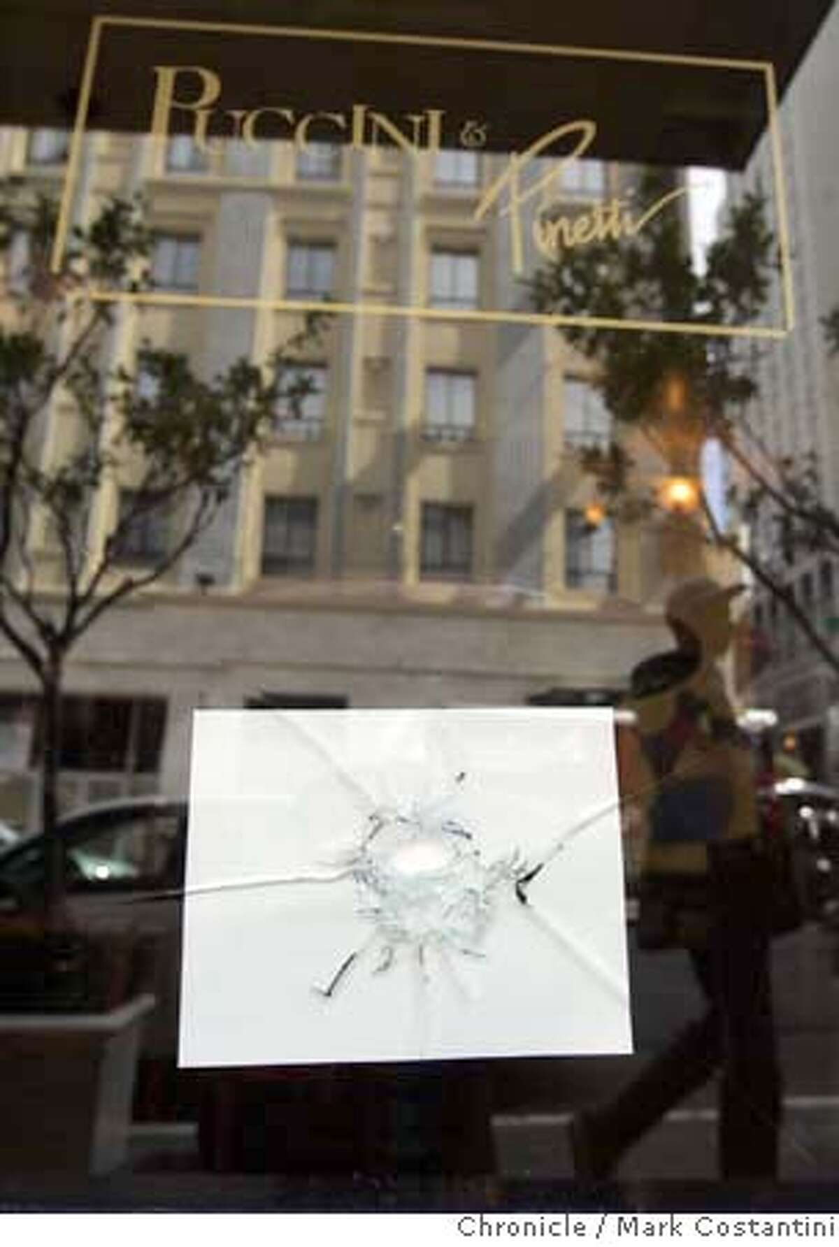 Bullet hole in window of Pucini and Pincetti Restaurant. The bullets narrowly missed patrons. For MR column. Photo: Mark Costantini / S.F. Chronicle