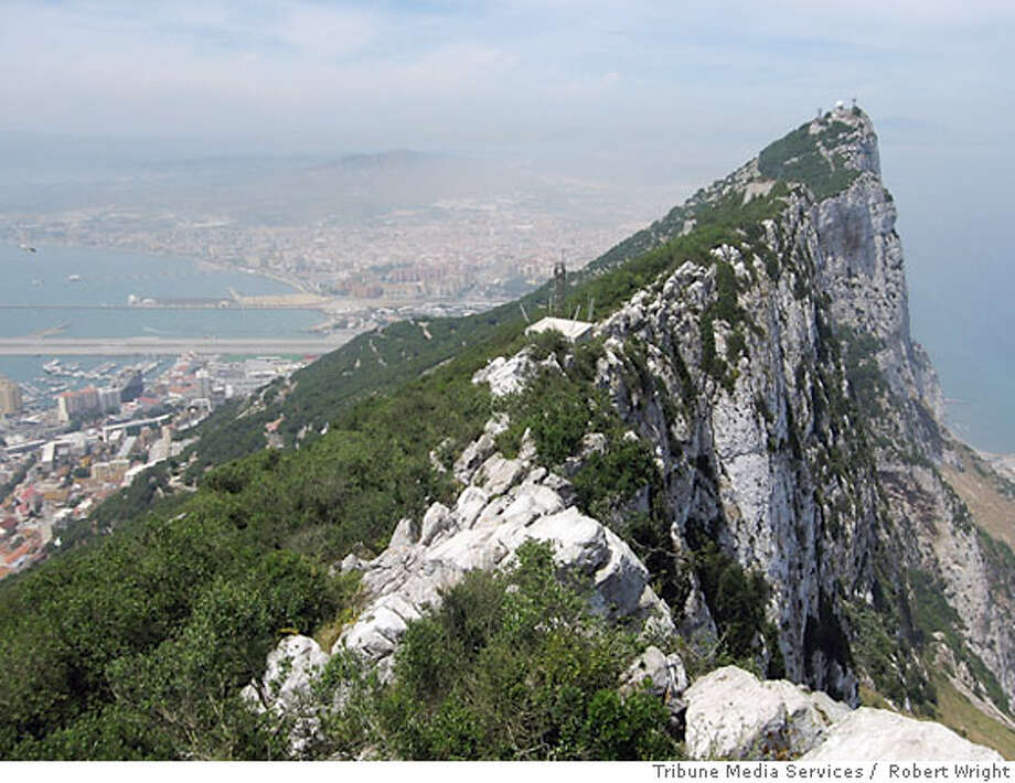 TRAVEL RICK STEVES GIBRALTAR -- The craggy, famous Rock of Gibraltar overlooks its namesake town below. Robert Wright / ? Photo: Robert Wright
