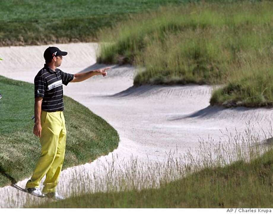 Sergio Garcia of Spain checks the church pew sand trap on the fourth fairway during his practice round for the 107th U.S. Open Golf Championship at the Oakmont Country Club in Oakmont, Pa., Tuesday, June 12, 2007. (AP Photo/Charles Krupa) Photo: Charles Krupa